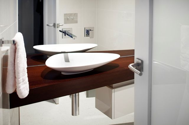 Powder room with contemporary basin keeping this home vibrant in all areas.