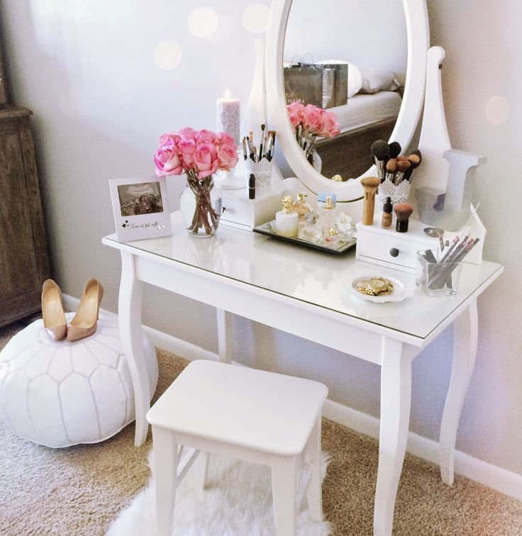 The perfect vanity isn't only a place for makeup and beauty products. Add personal touches like flowers and pictures.
