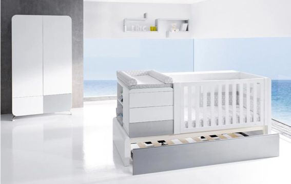 alondra premium knover cot 3 At one end of this sleek, stylish crib is a space for customizable drawers or shelving with a change pad on top. Keeping the essentials nicely together. The crib design is such that there is a solid side and a slatted side and these can easily be interchanged depending on where in the room the crib is to be placed. Tucked beneath this funky crib is a convenient trundle bed!