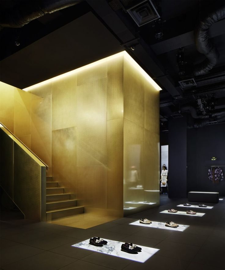 Theatrical lighting illuminates products inside the new black and gold Dolce & Gabbana store in Tokyo by French designer Gwenael Nicolas.