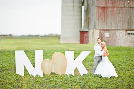 Oversized initials marked this couple's rustic reception site.