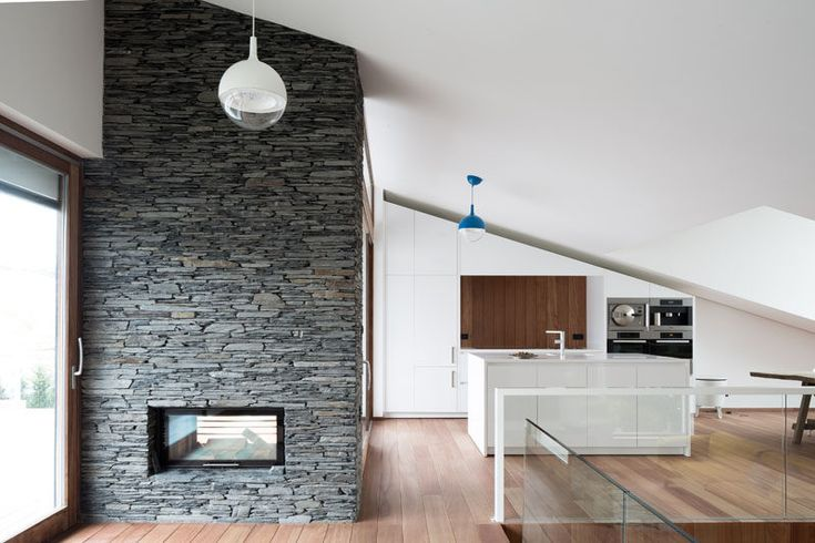 Fireplace Design Idea - 6 Different Materials To Use For A Fireplace Surround // Stacked grey stone surrounds this see-through fireplace.