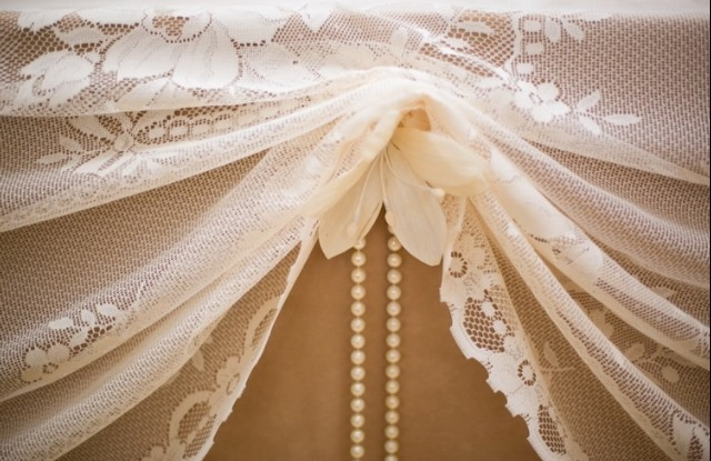 Lace and pearls. This would be a pretty vintage table décor. Lace overlay pinned up and trimmed with pearls. Vintage wedding ideas. Elegant wedding ideas.