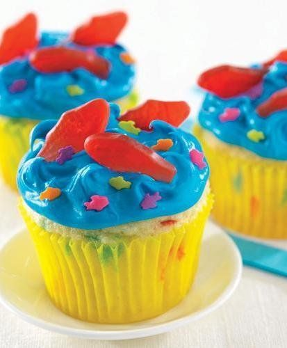 "Recipe For Aqua Blue Seaside Cupcakes - These are a fun treat to make for a pool party or a birthday. Children will love putting the fish in the ""water""!!"