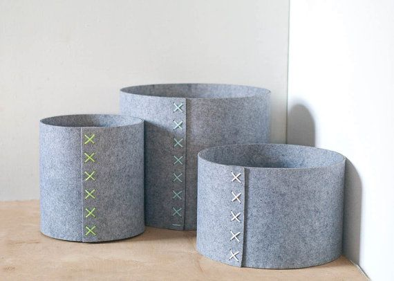 Set of 3 round storage bins with a colored cord. Made from high quality felt.  The storage basket is perfect for modern interior. Storage bin can