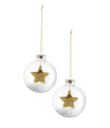 Clear glass Christmas ornaments with faux snow and shimmering stars inside. Metal hanger with glittery cord. Diameter approx. 3