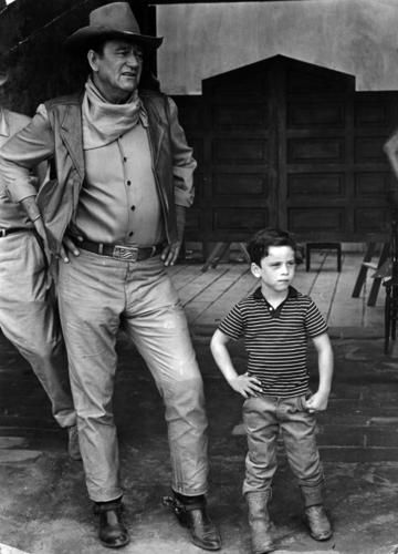 "1967: John Wayne, with his son, on location in Mexico for the filming of ""The War Wagon."" Love this movie!"
