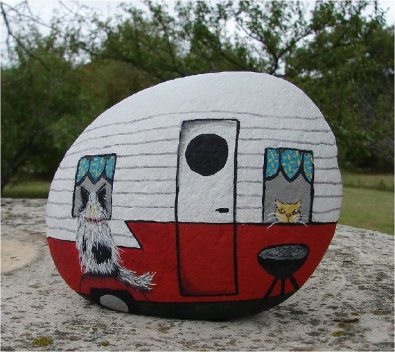 painted stone: Vintage RV travel trailer with dog and cat