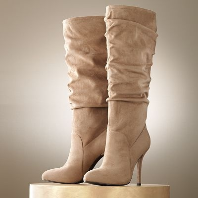 Jennifer Lopez Tall Boots .... I tried these on at Kohl's. Gorgeous but very uncomfortable.