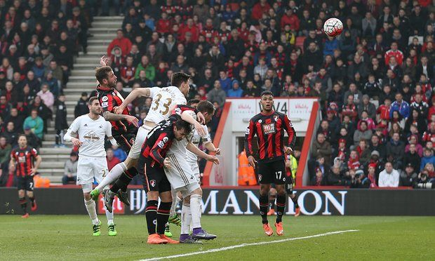Bournemouth 3  Swansea City 2: Steve Cook (second left) heads home the winner for Bournemouth, who edge closer to Premier League safety