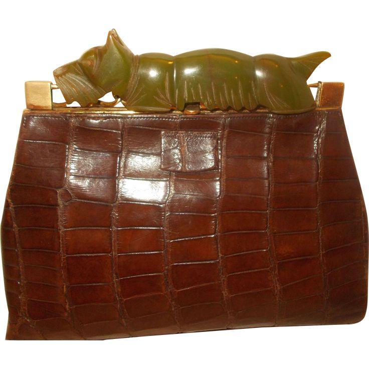 Art deco 1930's crocodile clutch handbag with a huge perfect carved Bakelite dog clasp very rare bag