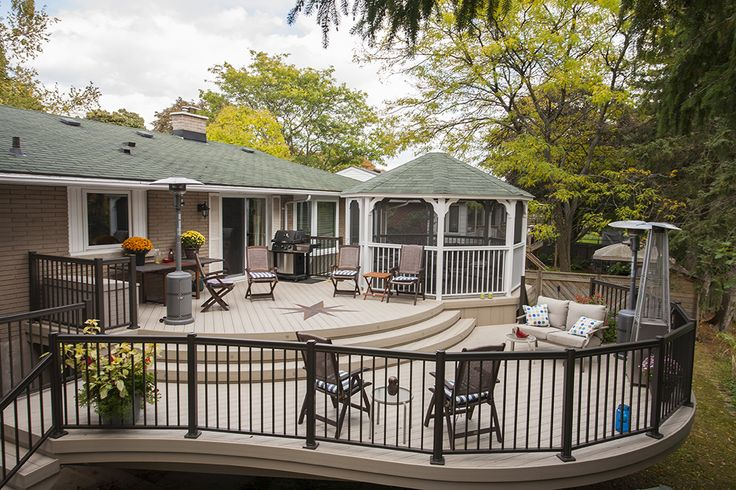 This curved custom deck was built in Kitchener Ontario in 2014 by Hickory Dickory Decks using Veka decking and aluminum rails.