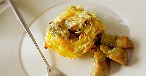 Nidi di tagliatelle all'uovo con carciofi ricetta di pasta condita con salsa di ricotta e carciofi gratinata a forno creando dei piccoli nidi di verdura
