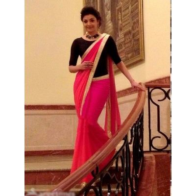 Angelic Pink Georgette Designer Saree comes with Black  Color Silk Blouse. It contained the Embroidery work with Lace Border. The Blouse can be customized up to bust size 44