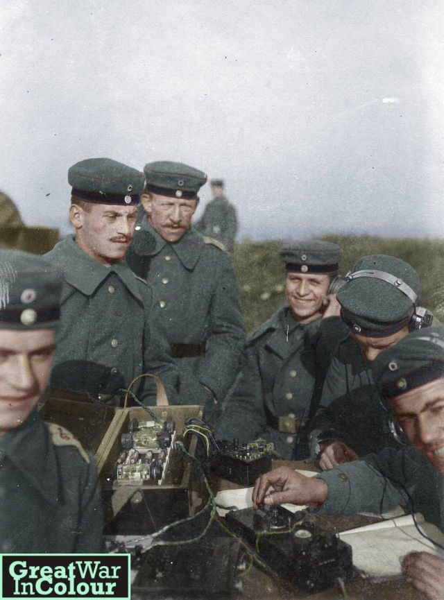 A group of young German radio operators working in a field.