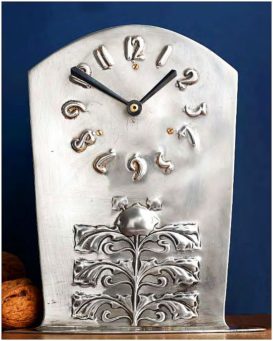 ✨ A Liberty & Co silver Cymric mantel clock, embossed with a foliate motif and stylised numerals, hallmarked Liberty & Co Ltd, Birmingham 1902. 'Cymric' silver was a brand name of gold and silverware by Liberty & Co, equivalent to the pewter design Tudric; aptly named to refl ect its Celtic-inspired designs. Archibald Knox created most of the designs for the range, alongside designers Rex Silver and Arthur Gaskin.