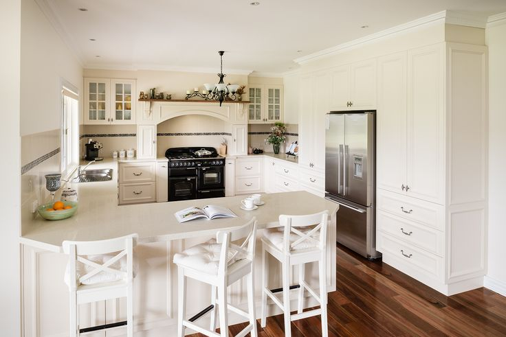 "VINTAGE CLASSIC This charming kitchen is as warm as homemade apple pie. Proving you don't need to sacrifice the modern appliances to achieve an authentic vintage style. ""Belinda"" used here, is just one in Albedor's quality range of recess panel doors. For more info go to www.albedor.com.au"
