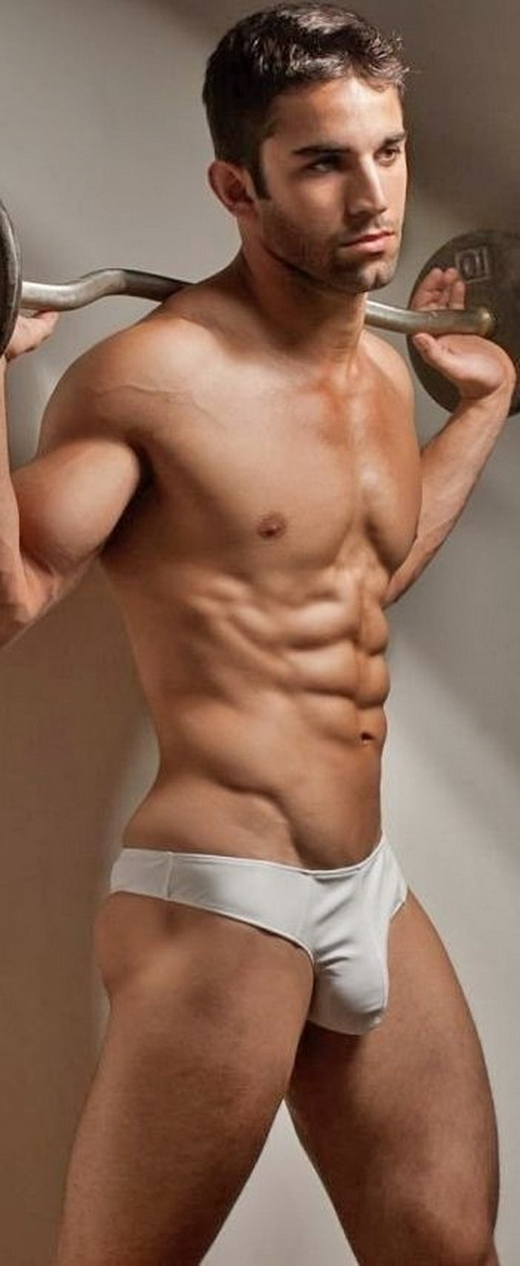 Topless hot guy putting his pants in