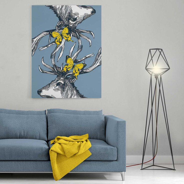 A beautiful, ready to hang stretched canvas print in a variety of size options.    With his intricately intertwining antlers and bold yellow butterflies, Mr Stag and his reflection make a big impact! On a modern bluey-grey background, this print will add some funky Scottish magic to any room or hallway.   Pair with our