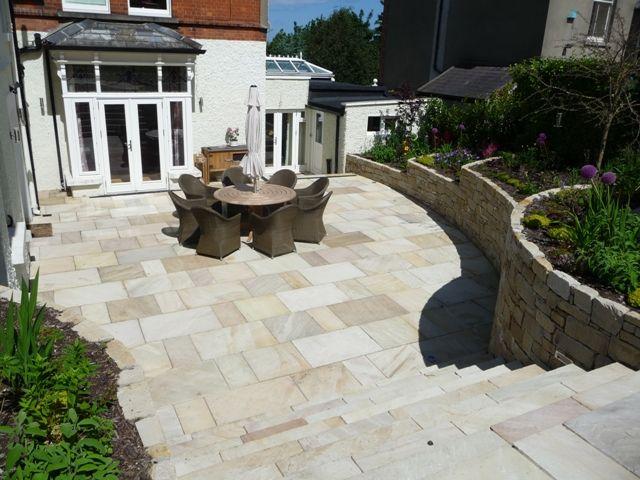 Large sandstone terrace in Dalkey Garden - by MAXIMIZE DESIGN
