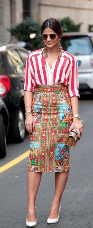 This skirt is fantastic, but I would pair it with a solid color top pulled from the skirt.