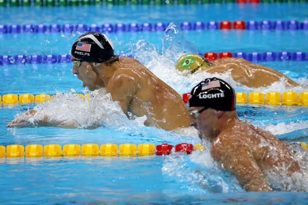 Michael PHelps pulls away from Ryan Lochte and the rest of the field during the third leg of the 200-meter individual medley on Thursday. (Robert Gauthier / Los Angeles Times)