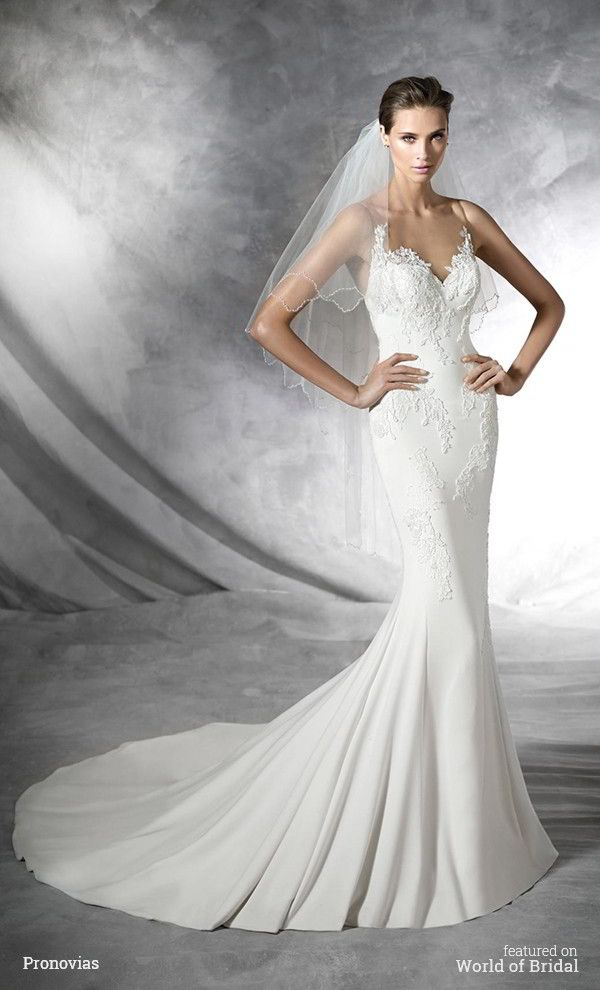 Mermaid dress encrusted with gemstone embroidery in crepe with lace appliqués, thread embroidery. Bodice with sheer overlay adorned with appliqués. Sheer effect back adorned with lace and thread appliqués. #wedding #dresses #bridal #gown #dress