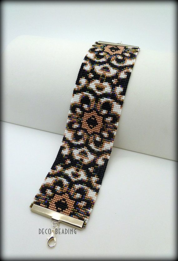 """This pattern is my Original Design, """"Centered Flower"""", which is done on a Bead Loom using Size 11 Delica beads. This pattern does not include instructions for learning how to use a Bead Loom, so it is intended for users who already know how to use a loom. The bracelet will be 1.7""""X 7.78"""""""