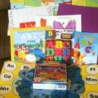 Hand sewn drawstring bag contains 3 books, 1 ABC Bubbles file folder game, 1 set of magnetic letters, 1 colorful puzzle (ages 3-up) and a list of T...