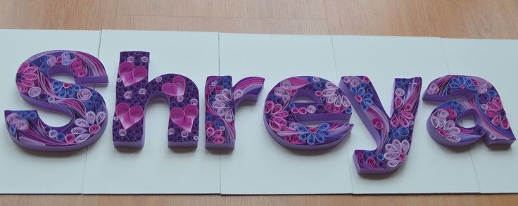 Quilled name for a name plate
