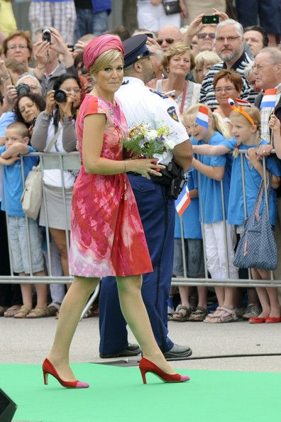 Queen Maxima Style File. Flag flaring at the 750th anniversary of Goor during an official visit to the town centre at 's Heerenbroek in Netherlands. June 13, 2013.