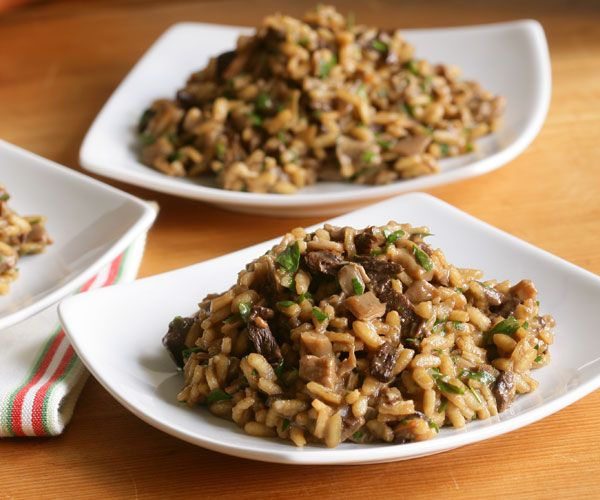 Wild Mushroom Risotto Recipe.  This wild mushroom risotto gets its deep flavor from a combination of dried and fresh mushrooms. A little drizzle of white truffle oil right before serving is delicious. For a very intense mushroom flavor, use mushroom liquor instead of chicken broth: simmer 2 oz. dried porcini in 5 cups of water for 5 minutes; let sit 30 minutes off the heat and strain, reserving the mushrooms.