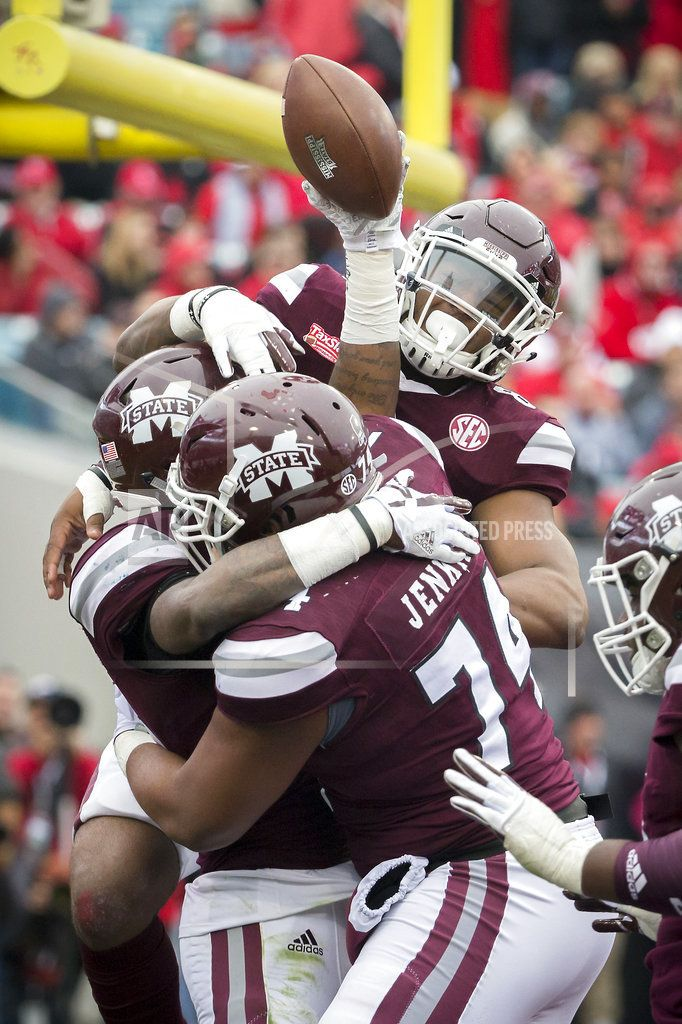JACKSONVILLE, Fla/December 30,2017(AP)(STL.News)— Freshman Keytaon Thompson, making his first start in place of injured quarterback Nick Fitzgerald, ran for 147 yards and three touchdowns to help No. 24 Mississippi State beat Louisville and 2016 Heisman Trophy winner Lamar Jackson 31-27 in the T... Read More Details: https://www.stl.news/thompson-carries-miss-state-to-31-27-victory-in-taxslayer/58708/