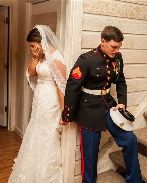 "U.S. Marine Corps Cpl. Caleb Earwood holds the hand of his now-wife, Maggie Earwood, while taking time to pray before saying ""I do."" - TODAY.com"