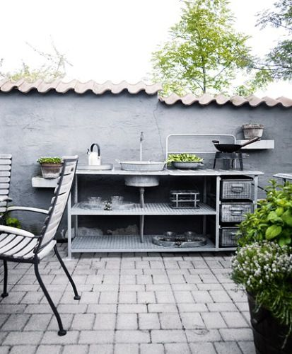 Exactly the sort of look that I want for our porch eating area. Outdoor Kitchen