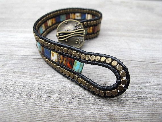 This Bohemian wristband is made with black leather, colorful Czech glass tiles and rounded cube beads. The glass is a wonderful mix of earthy colors -