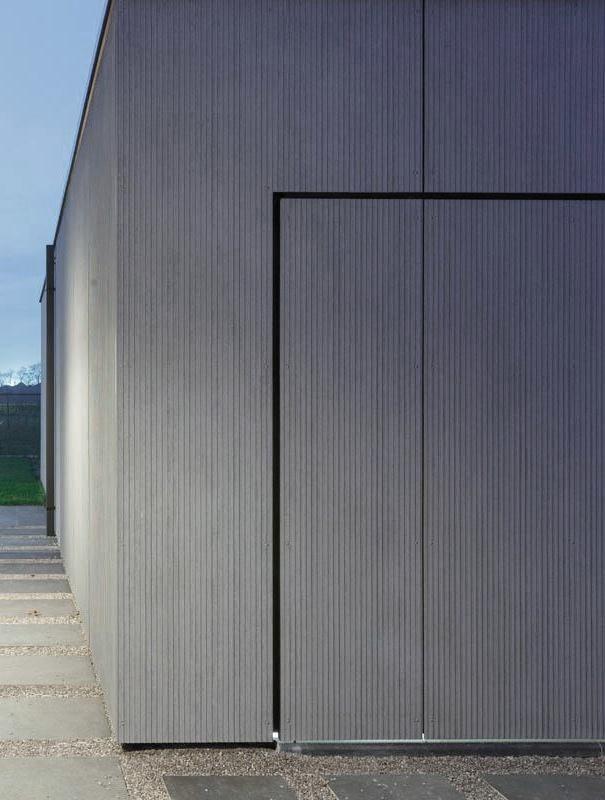 Garagedoor and facade seamless integration. Clad with EQUITONE facade panels. equitone.com