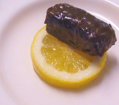 SWEET ALMOND TREE: 1: STUFFED GRAPE LEAVES WITH RICE 2: WHOLE FISH STUFFED IN GRAPE LEAVES