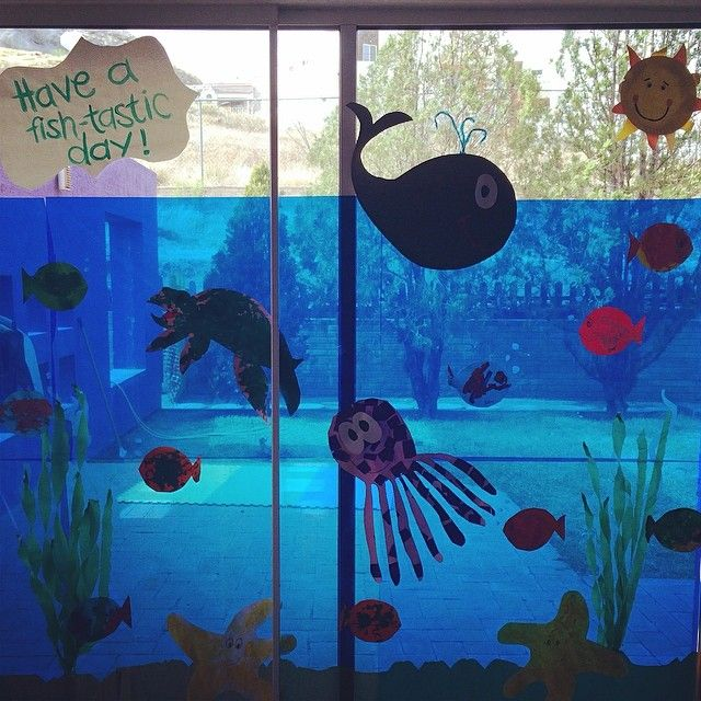 Aquarium in my toddlers classroom. They made the fishes, octopus, whale, turtle and starfishes. All the windows are cover with blue cellophane that creates the perfect aquarium atmosphere for kids to learn about the sea animals.