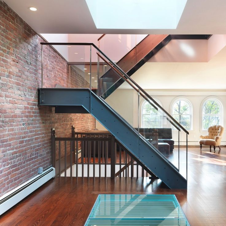 Attractive Metal Stair Stringers Brick Wall Upholstered Chair Hardwood Floors Glass  Railing Treads Ceiling Lights Modern Design Nice Look