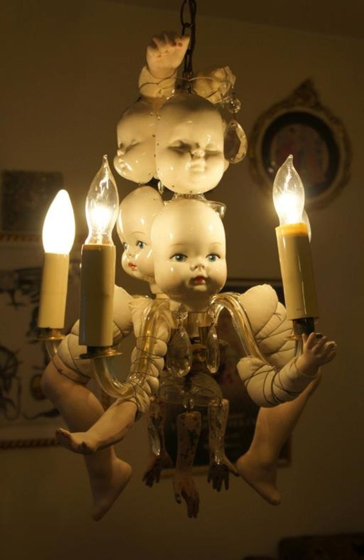 Doll parts added to an old chandelier.