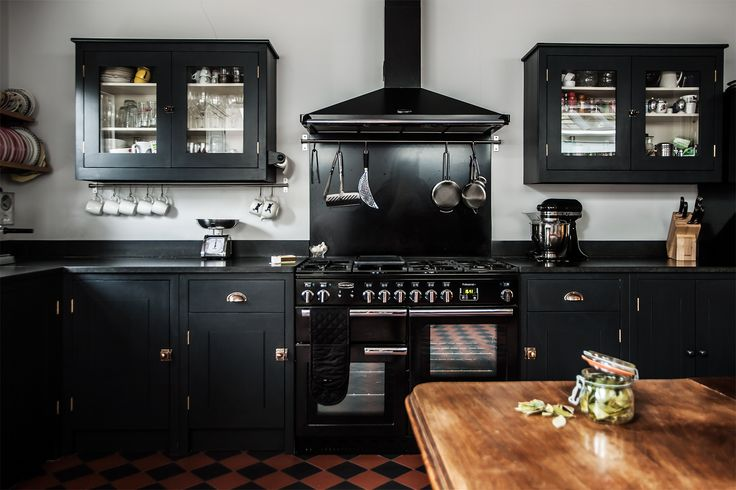 Alexis Hamilton Photography's shoot for British Standard Cupboards Featured in Beautiful Kitchens Magazine February 2014. Stunning Black Kitchen Design with Honed Black Granite Worktops and Georgian Brass Handles