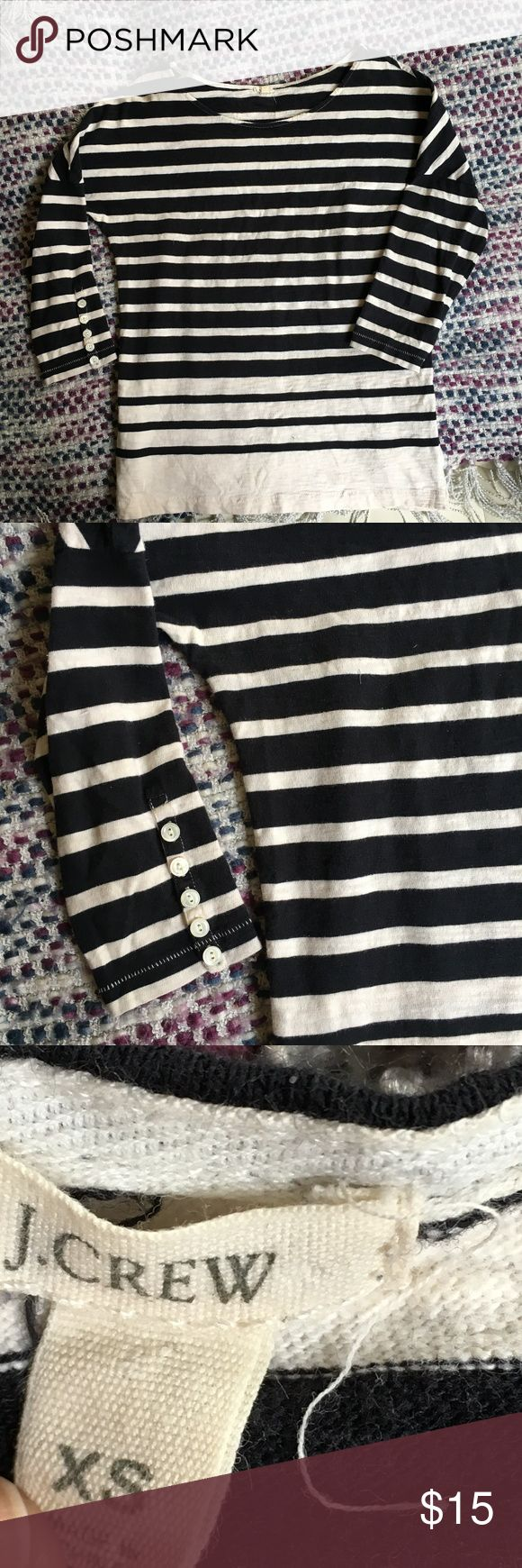 J. Crew ¾ Sleeve Navy and White Sweater J. Crew ¾ Sleeve Navy and White Sweater Stripes are dark navy and cream white.  Five buttons located on the end of each sleeve, all intact.  Size XS. J. Crew Sweaters Crew & Scoop Necks