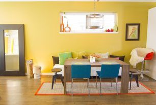 Eclectic Dining Room with Pendant Light, Mongstad Mirror, Abbyson Living Vale Dining Table, Hardwood floors