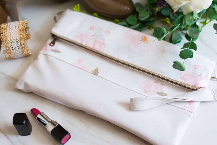I just listed this stunning clutch.  The blush floral print will be perfect for you, your bridesmaids or the mothers of the bride and groom.  Add on a wristlet or shoulder strap for the perfect bag! http://etsy.me/2EdKBJo