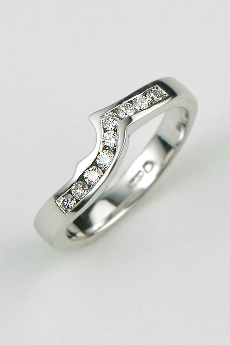 Superb a handmade channel set diamond shaped wedding ring designed to fit with the customer us engagement ring