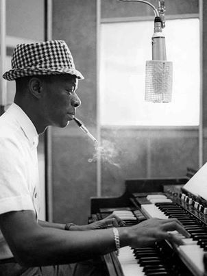 I love Nat King Cole. His silky voice and piano playing are soothing and transport me back in time... Wow, that sounded strangely professional...