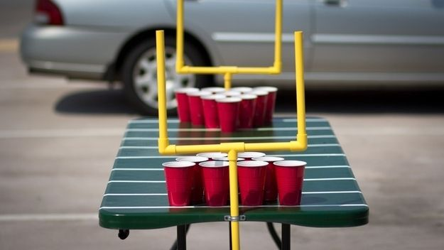 Keep 'em entertained with this custom beer pong table. | 39 Clever Tailgating DIYs To Get You In The Spirit