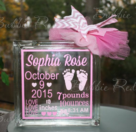 "Just imagine the look on the faces of the new parents as they open this gift…Their new baby girl's birth statistics forever displayed on a glass block ""Piggy"" Bank. This personalized glass block makes a beautiful and unique nursery decor item. What a thoughtful gift!  The glass block measures a large 7 1/2"" x 7 1/2"". The vinyl colors shown are light and dark pink.  The beautiful ribbon and tulle bow adds that finishing touch. The acrylic cap is easily removed to access the money.  All…"