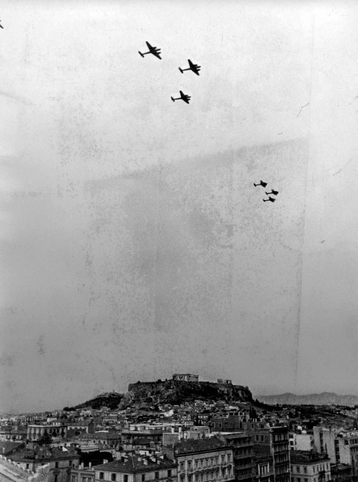 German Bf.110 fighter aircraft execute an overfly of downtown Athens, Greece in the autumn of 1941. The Acropolis is clearly visible. Very few of the buildings in this photo still stand. Athens was occupied in April 1941 and liberated in October 1944.